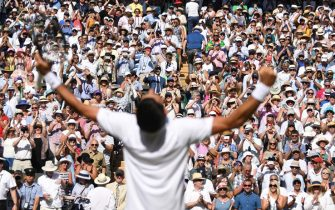 epa06891227 Novak Djokovic of Serbia celebrates defeating Kevin Anderson of South Africa in the men's singles final of the Wimbledon Championships at the All England Lawn Tennis Club, in London, Britain, 15 July 2018.  EPA/NEIL HALL EDITORIAL USE ONLY/NO COMMERCIAL SALES