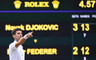 epaselect epa07717379 Novak Djokovic of Serbia celebrates winning against Roger Federer of Switzerland during their Men's final match for the Wimbledon Championships at the All England Lawn Tennis Club, in London, Britain, 14 July 2019. EPA/ANDY RAIN EDITORIAL USE ONLY/NO COMMERCIAL SALES