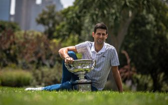 epa08189648 Novak Djokovic of Serbia poses for photos with the Norman Brookes Challenge Cup the day after winning the Men's Singles Final at the Australian Open grand slam tennis tournament, in Melbourne, Australia, 03 February 2020.  EPA/ROMAN PILIPEY