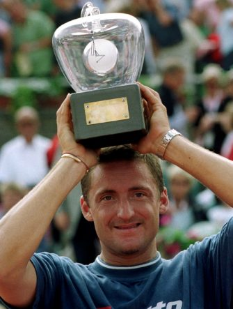 STO01-20010715, STOCKHOLM, SWEDEN: Italian player Andrea Gaudenzi poses with his trophy after winning the Men's Single Final against Czech player Bohdan Ulihrach at the Swedish Open in Bastad, Sunday 15 July 2001. Gaudenzi won 7-5, 6-3.EPA PHOTO/PRESSENS BILD/ARNE FORSELL