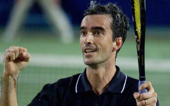 PER19 - 20020102 - PERTH, AUSTRALIA : Italy's Davide Sanguinetti celebrates after winning over Jan-Michael Gambill of the USA at the Hopman Cup mixed teams' tennis event at the Burswood Dome in Perth, 02 January 2002. Sanguinetti won in straight sets 7-6 (7/1), 6-3, to give his country a two rubbers to nil lead in the tie, after Francesca Schiavone defeated Monica Seles in a hard fought three set match 6-4, 2-6, 6-4.   EPA PHOTO AFPI/GREG WOOD
