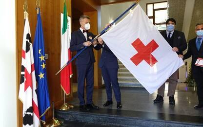 Giornata mondiale Croce Rossa, bandiera Cri a Villa Devoto