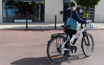 SAINT GERMAIN EN LAYE, FRANCE - MAY 13: A bicycle rider is seen in front of a bike shop on May 13, 2020 in Saint Germain en Laye, France. The Coronavirus (COVID-19) pandemic has spread to many countries across the world, claiming over 246,000 lives and infecting over 3.5 million people. (Photo by Pascal Le Segretain/Getty Images)