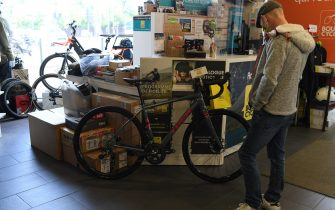 SAINT GERMAIN EN LAYE, FRANCE - MAY 13: A customer looks at his bicycle in a bike shop on May 13, 2020 in Saint Germain en Laye, France. The Coronavirus (COVID-19) pandemic has spread to many countries across the world, claiming over 246,000 lives and infecting over 3.5 million people. (Photo by Pascal Le Segretain/Getty Images)