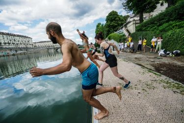 A moment of the event of Legambiente  ''Big Jump a dip in the river Po'', to raise public awareness on the quality of water, Turin, Italy, 12 July 2020.   ANSA/TINO ROMANO
