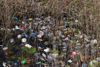 CARDIFF, UNITED KINGDOM - MAY 02: Single use plastic bottles seen floating in polluted water near Cardiff Bay on May 2, 2018 in Cardiff, United Kingdom. (Photo by Matthew Horwood/Getty Images)