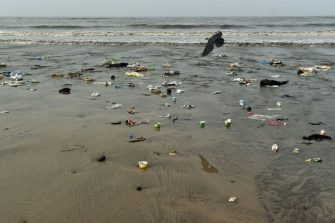 TOPSHOT - In this photograph taken on September 14, 2019 plastic waste and trash is seen on Versova beach in Mumbai. - Facing severe flooding as sea levels rise, authorities in India's financial capital Mumbai are building bunds and restoring coastal mangrove trees to protect the vulnerable mega-city. (Photo by PUNIT PARANJPE / AFP) / TO GO WTIH:  UN-climate-India-science-oceans-Mumbai, FOCUS by Vishal MANVE (Photo by PUNIT PARANJPE/AFP via Getty Images)