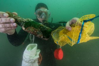 MARSEILLE, FRANCE - OCTOBER 2016: A diver from Septentrion Environnement is picking up various waste during a cleaning operation of the historic harbor of Marseille on October 08, 2016, Provence, France. This cleaning operation, organized by the federation of nautical societies of Bouches du Rhone, mobilized a hundred divers who collected more than one hundred cubic meters of waste in just two hours. (Photo by Alexis Rosenfeld/Getty Images)
