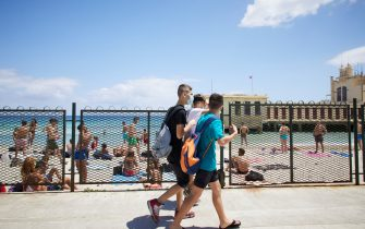 PALERMO, ITALY - JUNE 07:  Some boys walk on Mondello beach on the first day of reopening of the bathing facilities after the lockdown on June 07, 2020 in Palermo, Italy. Many Italian businesses have been allowed to reopen, after more than two months of a nationwide lockdown meant to curb the spread of Covid-19. (Photo by Lorenzo Palizzolo/Getty Images)