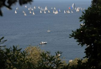 PORTOFINO, ITALY - MAY 01:  A flotilla of yachts head out to sea at the start of the 40th Pirelli Yacht Race on May 1, 2009 in Portofino, Italy.  (Photo by Luca Ghidoni/Getty Images)
