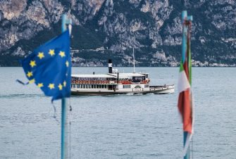 BRENZONE, ITALY - AUGUST 15:  A damaged European flag is seen alongside an Italian flag wrapped around a pole as a ferry passes on Lake Garda on August 15, 2019 in Brenzone, Italy. (Photo by Michel Porro/Getty Images)