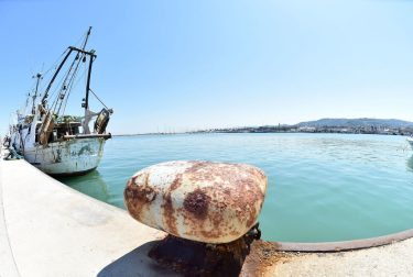 SAN BENEDETTO DEL TRONTO, ITALY - APRIL 24:  The fishing boats are moored and empty at the port of San Benedetto del Tronto because due to Covid-19 all commercial activities are closed.on April 24, 2020 in San Benedetto del Tronto, Italy. Italy will remain on lockdown until May 4th to stem the transmission of the Coronavirus (Covid-19), but some industries are being allowed to reopen.  (Photo by Giuseppe Bellini/Getty Images)