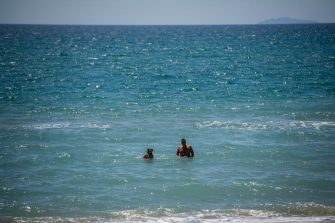 TERRACINA, ITALY - MAY 07: People swim in the empty sea about 100 km (80 miles) south of Rome during the fourth day of the so called phase two due to the Coronavirus (Covid-19) pandemic, on May 7, 2020 in Terracina, Italy. Italy was the first country to impose a nationwide lockdown to stem the transmission of the Coronavirus (Covid-19), and its restaurants, theaters and many other businesses remain closed. (Photo by Antonio Masiello/Getty Images)