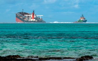A picture taken on August 15, 2020 near Blue Bay Marine Park, shows the vessel MV Wakashio, belonging to a Japanese company but Panamanian-flagged, that ran aground near Blue Bay Marine Park off the coast of south-east Mauritius. - A fresh streak of oil spilled on August 14, 2020, from a ship stranded on a reef in pristine waters off Mauritius, threatening further ecological devastation as demands mount for answers as to why the vessel had come so close to shore. (Photo by Fabien Dubessay / AFP) (Photo by FABIEN DUBESSAY/AFP via Getty Images)