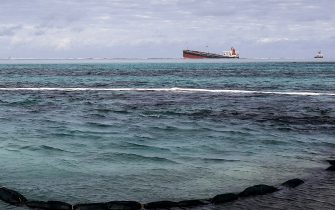 A picture taken on August 15, 2020 shows the partially submerged Japanese owned Panama-flagged bulk carrier MV Wakashio at the time when the mid section of the vessel broke in two, after it ran aground near Blue Bay Marine Park off the coast of south-east Mauritius three weeks ago. - France on August 8, 2020 dispatched aircraft and technical advisers from Reunion to Mauritius after the prime minister appealed for urgent assistance to contain a worsening oil spill polluting the island nation's famed reefs, lagoons and oceans. Rough seas have hampered efforts to stop fuel leaking from the bulk carrier MV Wakashio, which ran aground two weeks ago, and is staining pristine waters in an ecologically protected marine area off the south-east coast. (Photo by STRINGER / AFP) (Photo by STRINGER/AFP via Getty Images)