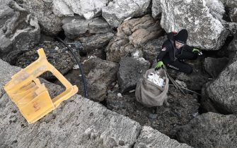 Volunteers from Aegean Rebreath, a Greek organisation formed in 2017 to protect Aegean biodiversity from waste, collect rubish retrieved from the sea, at the port of the island of Zakynthos on November 23, 2019. - Within three hours a team of a dozen volunteers from Aegean Rebreath, a Greek organisation formed in 2017 to protect Aegean biodiversity from waste, collects four tyres, two shopping carts, a street lamp, metal boxes, plastic bags, dozens of plastic bottles and several kilometres of fishing line. In its two years of operation, Aegean Rebreath has amassed 9,000 plastic water bottles, 3,6 tons of fishing net and 289 tyres. The Mediterranean, a partly closed sea, accumulates 570,000 tons of plastic annually from surrounding countries, according to the World Wildlife Fund. (Photo by LOUISA GOULIAMAKI / AFP) (Photo by LOUISA GOULIAMAKI/AFP via Getty Images)
