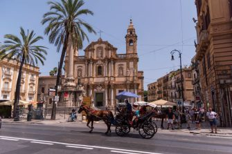 """PALERMO, ITALY - AUGUST 8: A horse-drawn Carriage in motion in front of Church of Saint Dominic that is the second most important church of Palermo after the ancient cathedral on August 8, 2019 in Palermo, Italy. Located in Piazza San Domenico, in the quarter of the Loggia, within the historic centre of Palermo, the church hosts the burials of many eminent figures of Sicilian history and culture. For this reason it is known as the """"Pantheon of illustrious Sicilians."""" (Photo by Stefano Montesi - Corbis/Getty Images)"""