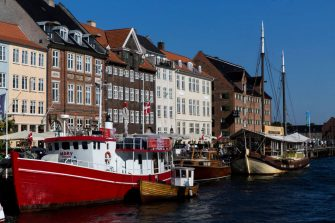 """COPENHAGEN, DENMARK  AUGUST 25: Colorful old houses in the historic Nyhavn on August 25, 2019 in Copenhagen, Denmark. Nyhavn means """"New Harbour"""" but it is actually the old harbor from the 17th century. With several restaurants, bars and old houses (the oldest is from 1681) it is one of Copenhagen's main tourist attractions. (Photo by Ole Jensen/Getty Images)"""