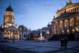 BERLIN, GERMANY - APRIL 01: A small amount of people walk near the empty square Gendarmenmarkt during the coronavirus crisis on April 01, 2020 in Berlin, Germany. The coronavirus and the disease it causes, Covid-19, are having a fundamental impact on society, government and the economy in Germany. Public life has been restricted to the essentials in an effort by authorities to slow the spread of infections. Hospitals are scrambling to increase their testing and care capacity. An economic recession seems likely as economic activity is slowed and many businesses are temporarily closed. Schools, daycare centers and universities remain shuttered. And government, both federal and state, seek to mobilize resources and find adequate policies to confront the virus and mitigate its impact. (Photo by Maja Hitij/Getty Images)