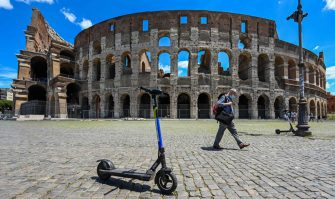 TOPSHOT - A view shows shared electric scooters parked in front of the Coliseum monument on June 22, 2020 in Rome, as the country eases its lockdown aimed at curbing the spread of the COVID-19 infection, caused by the novel coronavirus. - With deconfinement and good weather, self-service shared electric scooters have invaded the streets of Rome in recent days, a novelty in the Eternal City, which in turn is discovering the joys and nuisances of new forms of mobility. (Photo by Vincenzo PINTO / AFP) (Photo by VINCENZO PINTO/AFP via Getty Images)