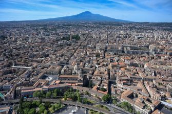 CATANIA, ITALY - MAY 01: Aerial view of Catania, in the background the volcano Etna, during an operational mission from the Coast Guard helicopter on May 01, 2020 in Catania, Italy. Italy is still on lockdown to stem the transmission of the Coronavirus (Covid-19), but slowly easing restrictions. (Photo by Fabrizio Villa/Getty Images)