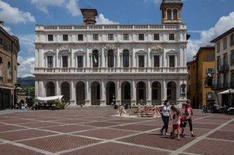 BERGAMO, ITALY - JUNE 18: A family strolls in the main Old Square in the Upper Town on June 18, 2020 in Bergamo, Italy. The city of Bergamo is slowly returning to normality after the lockdown for Covid-19 pandemic.  (Photo by Emanuele Cremaschi/Getty Images)