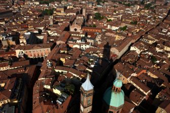 BOLOGNA, ITALY - MARCH 30: Bologna's iconic Two Towers, Le Due Torri, of Garisenda and Asinelli, cast their shadows over the city center and the domed Parish of Santi Bartolomeo and Gaetano on March 30, 2017 in Bologna, Italy. As many as 180 towers are believed to have been built between the 12th and the 13th centuries but only a few remain standing today. (Photo by David Silverman/Getty Images)