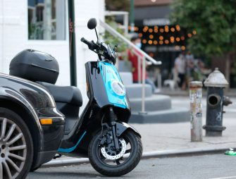 NEW YORK, NEW YORK - AUGUST 27: A Revel moped is parked unused on the street on August 27, 2020 in the Brooklyn borough of New York City. The app-based scooter sharing company announced today that it was back on city streets with new safety regulations in New York City and reviewed and strengthened safety measures after two customers were killed in separate crashes during the month of July while using the electric two-wheelers. Revel's rental scooters have become a common sight on the streets of New York City in recent weeks as residents shun public transport due to coronavirus pandemic. (Photo by Dimitrios Kambouris/Getty Images)