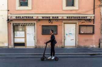 ROME, ITALY - SEPTEMBER 17:  A man passes a closed shop on Via del Corso on a scooter in the town centre on September 17, 2020 in Rome, Italy. With the COVID-19 pandemic and the almost total absence of foreign tourism, many shops and hotels will no longer reopen. (Photo by Stefano Montesi - Corbis/ Getty Images)
