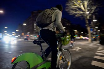 A man rides a Velib' bike-sharing system bike on a cycling path in Paris early on December 17, 2019 on the 13th day of a public transport strike as part of a nationwide multi-sector movement against French government pensions reform, and workers hold a third day of countrywide demonstration. (Photo by Aurore MESENGE / AFP) (Photo by AURORE MESENGE/AFP via Getty Images)