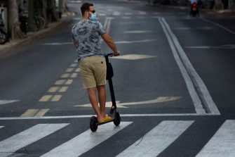TEL AVIV, ISRAEL - SEPTEMBER 18:  Israeli man rides a motor scooter at an empty road as Israel enters a new lockdown on  September 18, 2020 in Tel Aviv, Israel. As the country grapples with a surge in Covid-19 cases it has imposed a three-week lockdown that coincides with Rosh Hashanah, the Jewish new year, and Yom Kippur, the Day of Atonement.  (Photo by Amir Levy/Getty Images)