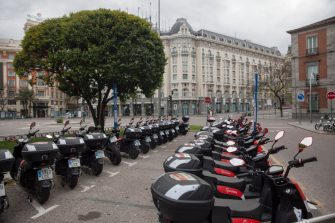 MADRID, SPAIN - APRIL 26. Bike-sharing motorcycles lined up unused in front of the Palace Hotel (closed) on April 26, 2020, in Madrid, Spain. Children in Spain, which has had one of the stricter lockdowns in Europe, are now allowed to leave their homes for up to an hour per day. The country has had more than 220,000 confirmed cases of COVID-19 and over 20,000 reported deaths, although the rate has declined after weeks of quarantine measures. (Photo by Miguel Pereira/Getty Images)
