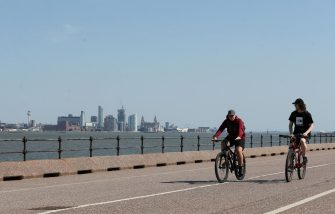 NEW BRIGHTON, UNITED KINGDOM - JUNE 25: Cyclists are seen enjoying the warm weather along the promenade overlooking the Liverpool waterfront on June 25, 2020 in New Brighton, United Kingdom. The UK is experiencing a summer heatwave, with temperatures in many parts of the country expected to rise above 30C and weather warnings in place for thunderstorms at the end of the week. (Photo by Lewis Storey/Getty Images)