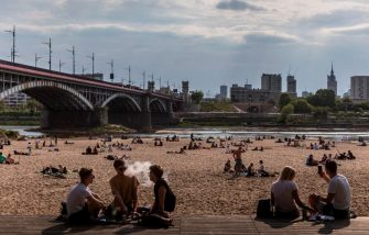 Warsaw residents crowdly gather on the bank of the Vistula River to enjoy the warm weather, despite the still uncontrolled pandemic of the new coronavirus COVID-19 and the restrictions and recommendations of social distancing, in Warsaw on May 10, 2020. (Photo by Wojtek RADWANSKI / AFP) (Photo by WOJTEK RADWANSKI/AFP via Getty Images)