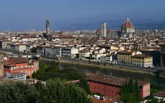 A picture taken from the heights of the city on September 14, 2020 shows a general view of Florence with the Arno river, the oldo bridge, the Palazzo Vecchio (C), the Giotto bell tower and the Santa Maria del Fiore Cathedral or Duomo (R) in the center of Florence. (Photo by MIGUEL MEDINA / AFP) (Photo by MIGUEL MEDINA/AFP via Getty Images)