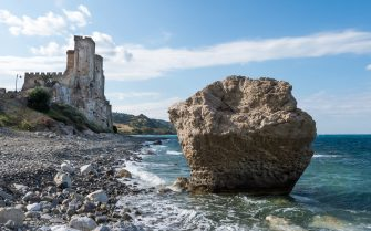 CASTLE, ROSETO CAPO SPULICO, CALABRIA, ITALY - 2017/05/21: The rock and the castle of Roseto Capo Spulico, awarded with the blue flag 2017, for its pristine sea and the services it offers. The Foundation for Environmental Education (Fee) has included Roseto Capo Spulico, Calabria, southern Italy, in the list of blue flag Italian beaches. (Photo by Alfonso Di Vincenzo/KONTROLAB /LightRocket via Getty Images)