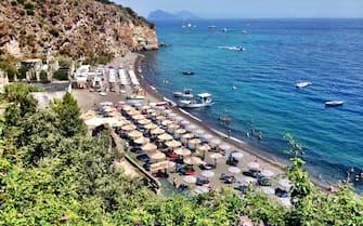 People at the White Beach in Lipari, Aeolian Islands, Italy