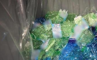 Bottiglie diplasticaschiacciate in occasione della presentazione del nuovo negozio Esselunga di via Triumplina a Brescia, 26 novembre 2019
