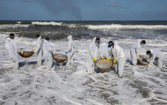 epa09244350 Sri Lanka Navy personnel, wearing protective gear, clear the beach from debris and other materials that washed ashore from the crippled container cargo vessel  MV X-Press Pearl, on the beach of Negombo, north-west of Colombo, Sri Lanka, 02 June 2021 (issued 03 June 2021). The fire on the Singaporean flagged container cargo vessel MV X-Press Pearl was doused and the salvage company began towing it towards deeper seas off the coast of Colombo on 02 June. However, the Sri Lanka Navy stated that the towing operation was halted as the stern of the ship was striking the seabed. Sri Lankan marine and coastal protection authorities warned about an environmental crisis as tonnes of plastic waste and pellets from the ship keep washing ashore. The island s Fisheries Ministry urged fishermen not to venture out to seas in the 80 km stretch along the western coast. Authorities such as the Marine Environmental Protection Authority (MEPA) are concerned over possible threats to the fish-breeding shallow waters of lagoons dotting the area, which is well known for its crabs and jumbo prawns as well as for its tourist beaches. MEPA is assessing the possible impacts on the mangroves, lagoons and marine wildlife in the region, while a possible oil leak would add to the devastation.  EPA/CHAMILA KARUNARATHNE