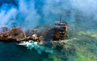 epa09243157 A handout photo made available by the Sri Lankan Air force Mediashows thefire gutted and crippled Singapore-registered container cargo vessel, MV X-Press Pearl, on the9 nautical miles northwest of Colombo port in Colombo, Sri Lanka, 02 June 2021. The fire on the Singaporean flagged container cargo vessel MV X-Press Pearl, which had been burning for over 13 days, was doused and the salvage company began towing it towards deeper seas off the coast of Colombo on 02 June. However, latest reports by the Sri Lanka Navy stated that the towing operation had been halted as the stern of the ship was striking the seabed. They also reported that so far no oil spills have been observed. A huge amount of plastic granules and debris has already washed ashore on beaches from Colombo to Negombo and authorities now fear another wave of massive pollution should the 278 tonnes of bunker oil and 50 tonnes of gas in the Singapore-registered ship's fuel tanks leak into the Indian Ocean.  EPA/SRI LANKAN AIR FORCE MEDIA HANDOUT  HANDOUT EDITORIAL USE ONLY/NO SALES