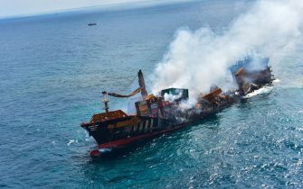 epa09243154 A handout photo made available by the Sri Lankan Air force Mediashows thefire gutted and crippled Singapore-registered container cargo vessel, MV X-Press Pearl, on the9 nautical miles northwest of Colombo port in Colombo, Sri Lanka, 02 June 2021. The fire on the Singaporean flagged container cargo vessel MV X-Press Pearl, which had been burning for over 13 days, was doused and the salvage company began towing it towards deeper seas off the coast of Colombo on 02 June. However, latest reports by the Sri Lanka Navy stated that the towing operation had been halted as the stern of the ship was striking the seabed. They also reported that so far no oil spills have been observed. A huge amount of plastic granules and debris has already washed ashore on beaches from Colombo to Negombo and authorities now fear another wave of massive pollution should the 278 tonnes of bunker oil and 50 tonnes of gas in the Singapore-registered ship's fuel tanks leak into the Indian Ocean.  EPA/SRI LANKAN AIR FORCE MEDIA HANDOUT  HANDOUT EDITORIAL USE ONLY/NO SALES
