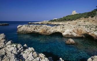 Rocky coast and watchtower near Santa Caterina, Nardo, Salento, Apulia, Italy.