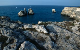 ITALY - CIRCA 2016: Rocky coast near Torre dell'Orso, with the Two Sisters sea stacks in the centre, Salento, Apulia, Italy. (Photo by DeAgostini/Getty Images)