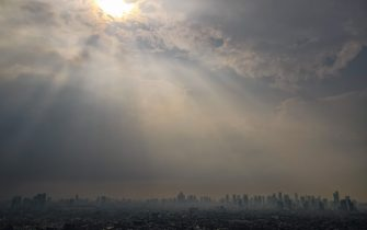 This aerial picture taken on June 9, 2021 shows air pollution over Jakarta. (Photo by BAY ISMOYO / AFP) (Photo by BAY ISMOYO/AFP via Getty Images)