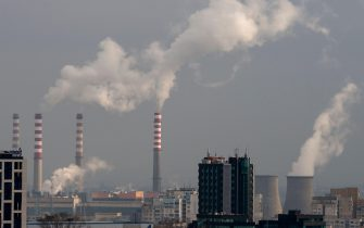 Morning view of smoking chimneys smoke stacks over residential suburban area in Sofia Bulgaria Eastern Europe EU January 2021 as pollution concept