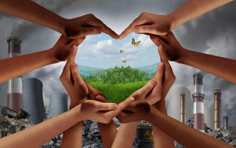 Earthday and earth day as group of diverse people joining to form heart hands together protecting the environment from toxic pollution promoting.