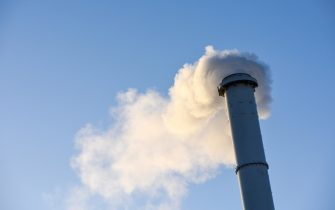 Smoke stall Chimney was pumping out black smoke pollution.