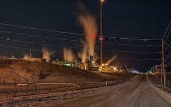 Night view of a gas plant near Cochrane, Alberta, Canada