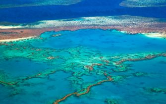Aerial view of the Great Barrier Reef of the Whitsundays in the Coral sea, Queensland, Australia. (Photo by: Arterra/Universal Images Group via Getty Images)