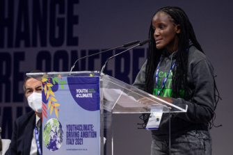 MILAN, ITALY - SEPTEMBER 28: Vanessa Nakate, Youth Climate Activist speaks from the podium during the Youth4Climate Pre-COP Youth Event at MiCo in Milan, Italy on September 28, 2021. (Photo by Piero Cruciatti/Anadolu Agency via Getty Images)